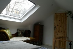 Attic bedroom with skylight